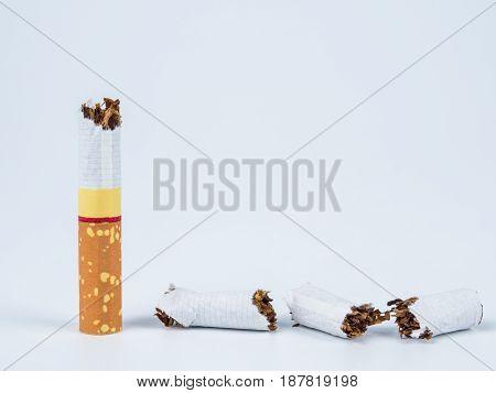 Broken Cigarette On White Background. World No Tobacco Day Concept.