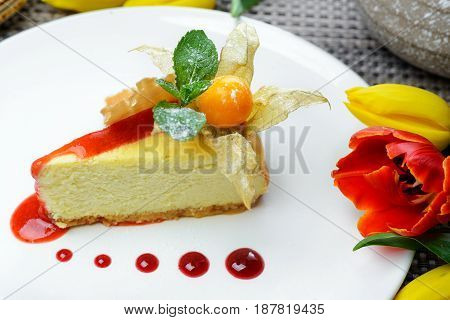 Cheesecake garnished physalis decorated with spring flowers