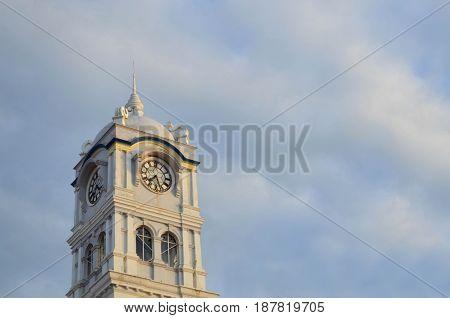 Penang clock tower against hazy blue sky at Penang Malaysia