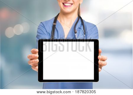 Nurse showing an empty tablet screen