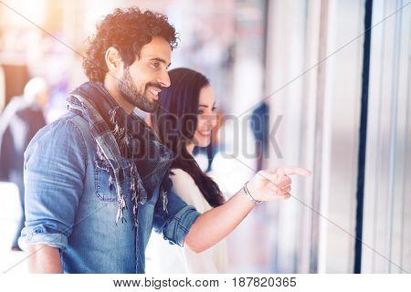 Couple shopping in an urban street
