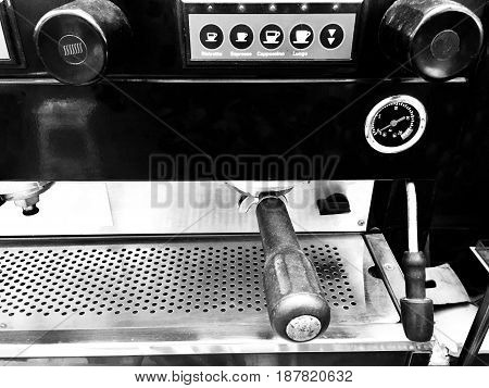 Coffee Time Close Up of Automatic Espresso Coffee Machine with A Group Head and Filter Holder in A Cafe.
