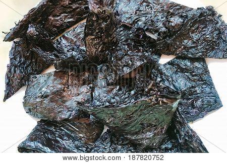 Close Up Sheet of Soaked Laminaria Seaweeds or Kelp Seaweeds on White Background.