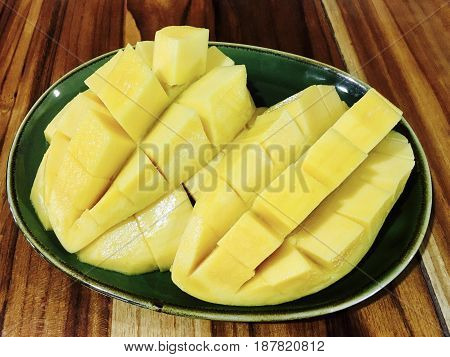 Fresh Fruit Fresh Ripe Golden Mango in Green Plate High in Vitamin C Vitamin B and Vitamin A.
