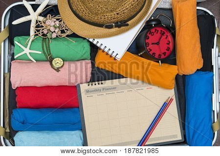 Travel planning and a traveler packing a luggage for a new journey