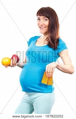 Happy Pregnant Woman Holding Fresh Fruits And Medical Pills Or Supplements, Choice Between Healthy F