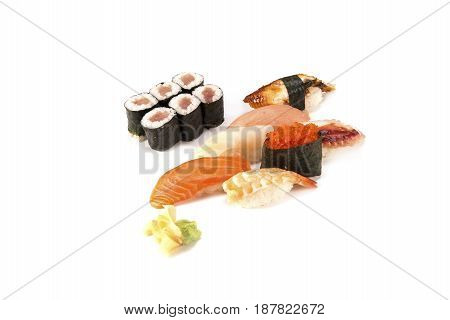 salmon and eel and a tuna roll combo on white