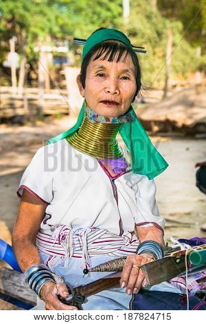 BAGAN, MYANMAR-MARCH 9, 2017. Portrait of  tribe woman with brass rings on her neck in handicraft shop of Bagan village on March 9, 2017. Myanmar.