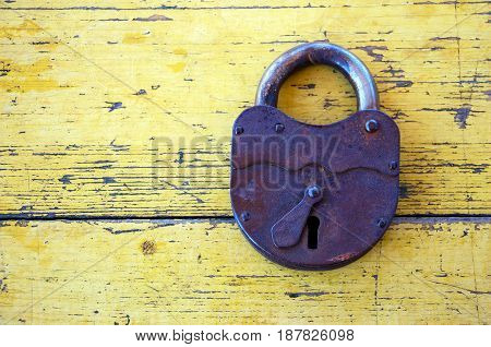 Old lock on the background of wooden boards painted with yellow paint 6