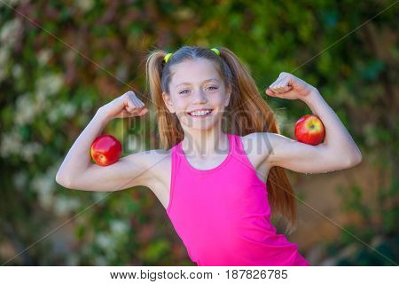 strong healthy girl with fruit