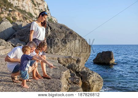 family on vacation by the sea
