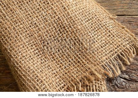 An abstract image of woven burlap texture.