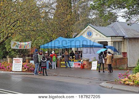LEURA AUSTRALIA - SEPTEMBER 25 2015: Shops and craft market on Leura Mall the main thoroughfare through Leura a gateway to the Blue Mountains of New South Wales Australia on a rainy spring day.