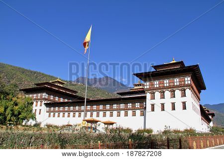 Flag Ceremony at Tashicho Dzong or Thimpu Palace. Buddhist monastery and fortress on the northern edge of the city of Thimpu in Bhutan.