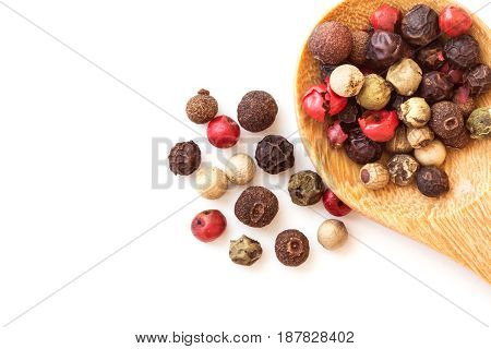 Close up mixed type of peppercorns in wooden spoon top view or overhead shot