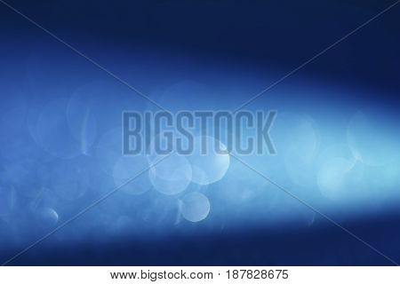 the Abstract elegant blue bokeh lighting for christmas or holiday background