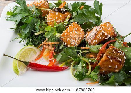 Spicy asian salmon salad with herbs and chili