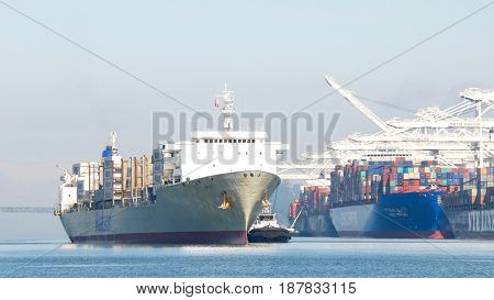 Oakland CA - May 22 2017: Matson cargo ship MAUI entering the Port of Oakland the fifth busiest port in the United States.