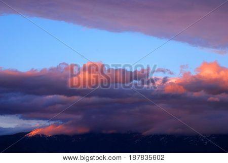 Sunset reflecting on clouds above the Swan Mountain Range near Kalispell, Montana