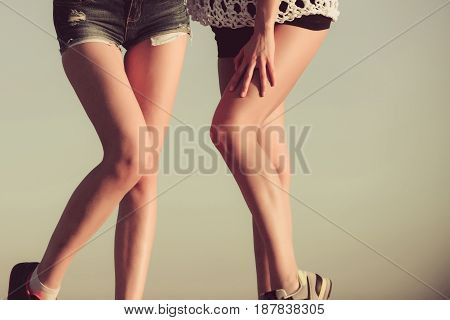 legs of sexy female legs with beautiful smooth soft silk skin outdoors on grey background. Hair removal. Waxing. Foot care. Health fitness