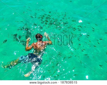 Tourist snorkeling in Andaman sea at Ko Kradan Island, Thailand. The blurred view
