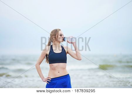 Runner Girl Drinking Water From On Running Break