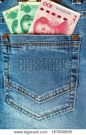 China yuan in the Pocket of the Jeans. Closeup