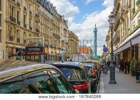 Paris France - May 2 2017: The road leading to the Place Vendôme with tourist bus and beautiful architecture on two sides of the street on May 2 2017 in Paris France.