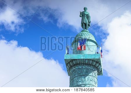 Paris France - May 2 2017: Vendome column with statue of Napoleon Bonaparte with cloudy day background on May 2 2017 in Paris France.