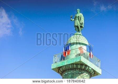 Paris France - May 2 2017: Vendome column with statue of Napoleon Bonaparte with blue sky background on May 2 2017 in Paris France.