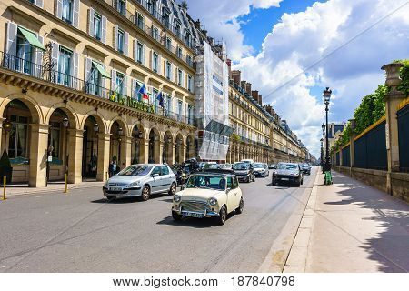 Paris France - May 2 2017: Traffic conditions on Rivoli street and the beautiful old architecture along the way with a cloudy background on May 2 2017 in Paris France.