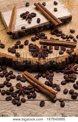 coffee beans and cinnamon  on wooden surface background