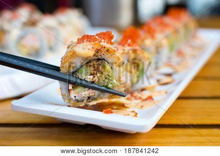 Eating Sushi Rolls With Chopsticks