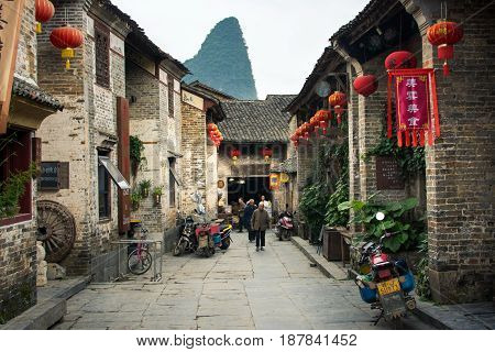 He Zhou, China - May 2, 2017: Residents Of Huang Yao Ancient Town In Zhaoping County Walking On The