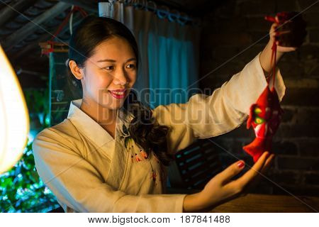 Chinese Girl Holding Good Luck Symbol