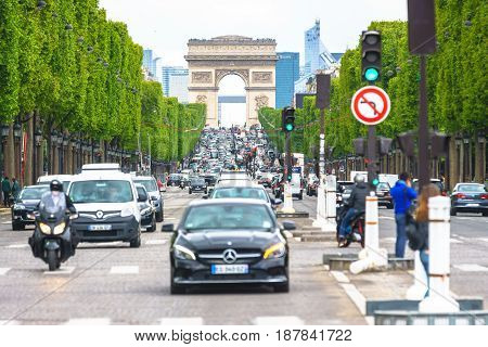 Paris France - May 3 2017: Road traffic conditions of Champs-Elysees Avenue views from Place de la Concord on May 3 2017 in Paris France.