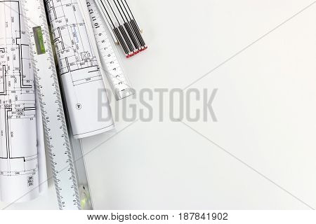 Spirit Level And Zigzag Ruler With Rolls Of Architectural Blueprints And Plans Top View