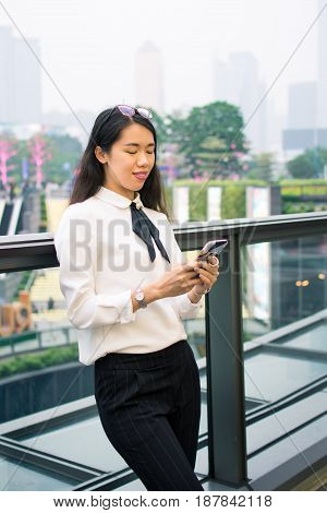 Business Woman Texting In Modern Environment