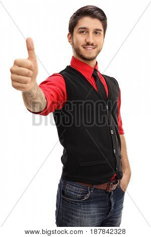 Tattooed young man making a thumb up gesture isolated on white background