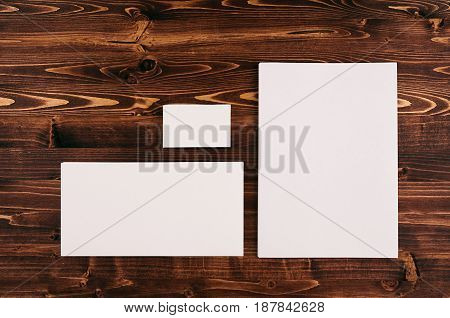 Corporate identity template stationery on vintage brown wooden board. Mock up for branding graphic designers presentations and portfolios.