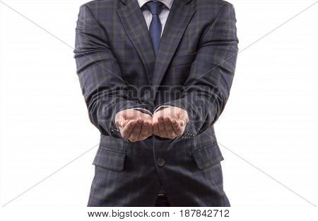 The man in the suit stretched out his arms and his hands joined together