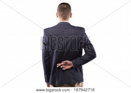 Businessman fingers crossed behind his back. Back view