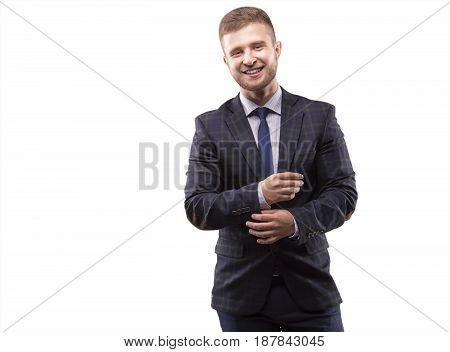 Young man in suit adjusts his cuffs and smiling
