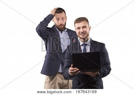 Two men looking at laptop with surprise