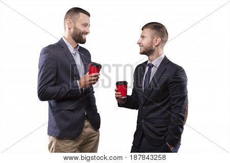 Two men standing with a cup of coffee in hand smiling and condemn interesting topic