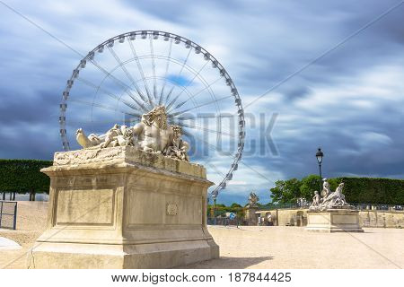 Paris France - May 2 2017: The Nile statue in the gardens of the Tuileries Gardens Paris France with cloudy in a background on May 02 2017 in Paris France.