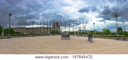 Paris France - May 2 2017: Panorama view of Monument to Cezanne statue in Tuileries Gardens with the Pavilion of Flore in a background with cloudy sky evening on May 02 2017 in Paris France.