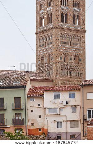 El Salvador. Mudejar art tower and buildings. Teruel. Spain heritage. Vertical