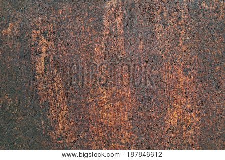 Old rusty iron metal wall with heavy corrosion background texture