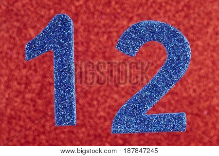 Number twelve blue color over a red background. Anniversary. Horizontal